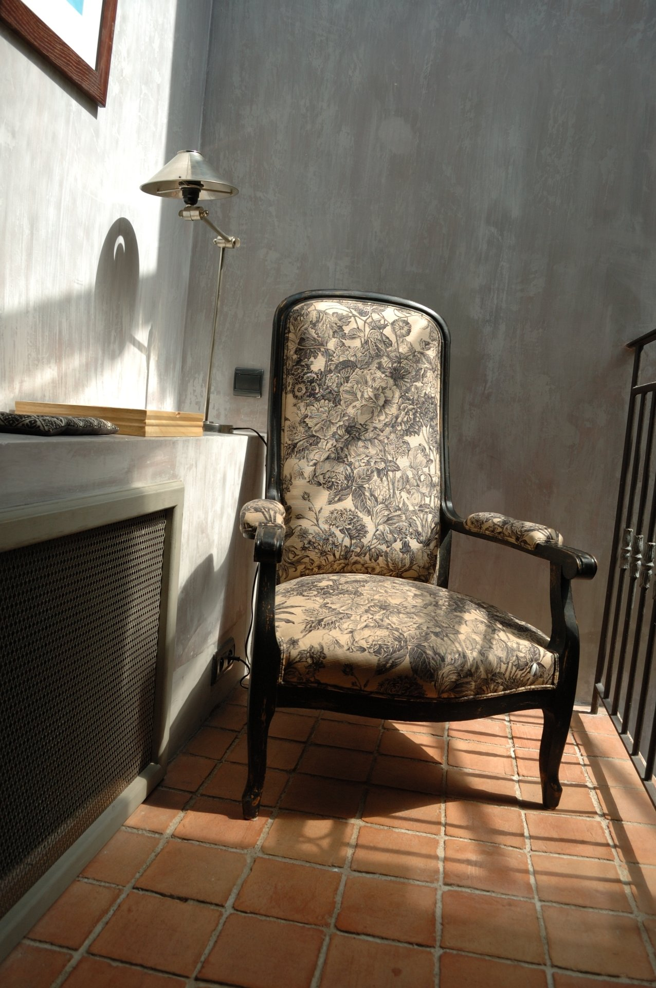 Designer fabric on antique armchair